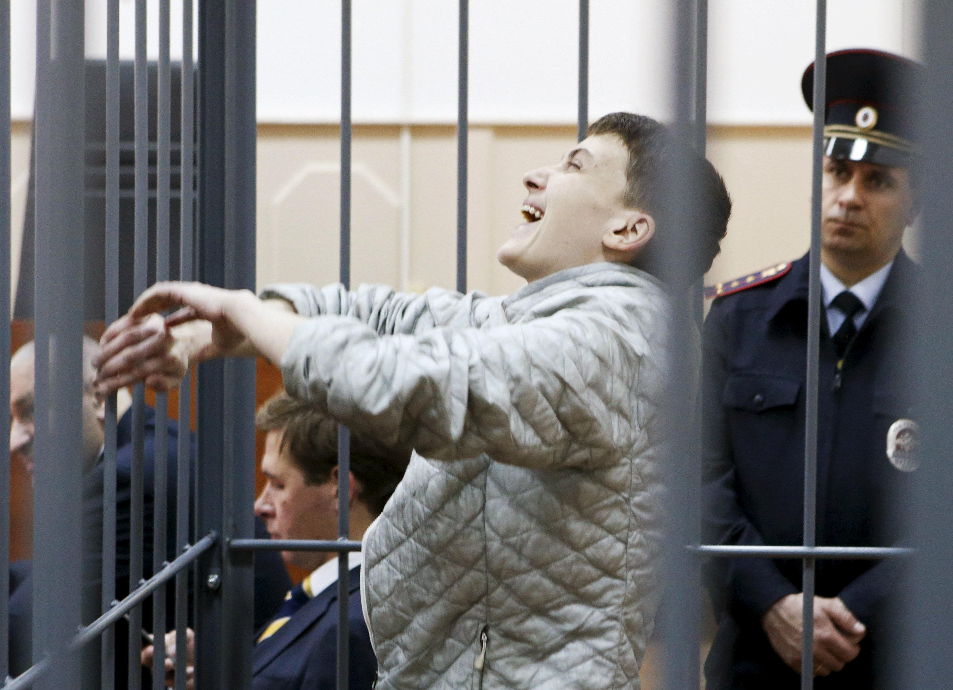Ukrainian military pilot Nadezhda Savchenko reacts inside a defendants' cage as she attends a court hearing in Moscow, Russia, May 6, 2015. Savchenko, who has become a symbol of resistance in Ukraine to what Kiev and the West see as Russian aggression, is being held in Moscow on charges of aiding the killing of two Russian journalists in east Ukraine last year. REUTERS/Sergei Karpukhin TPX IMAGES OF THE DAY